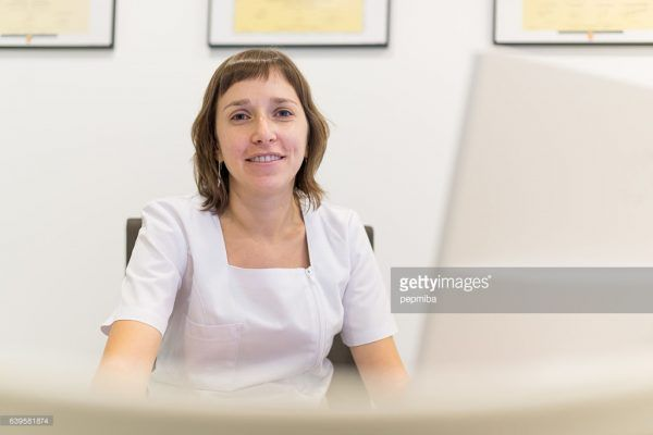 Nutritionist in her office working with computer