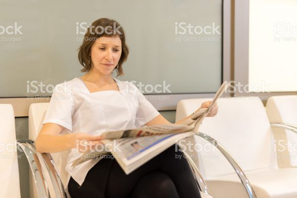 Woman, nutritionist, reading a newspapper during break time